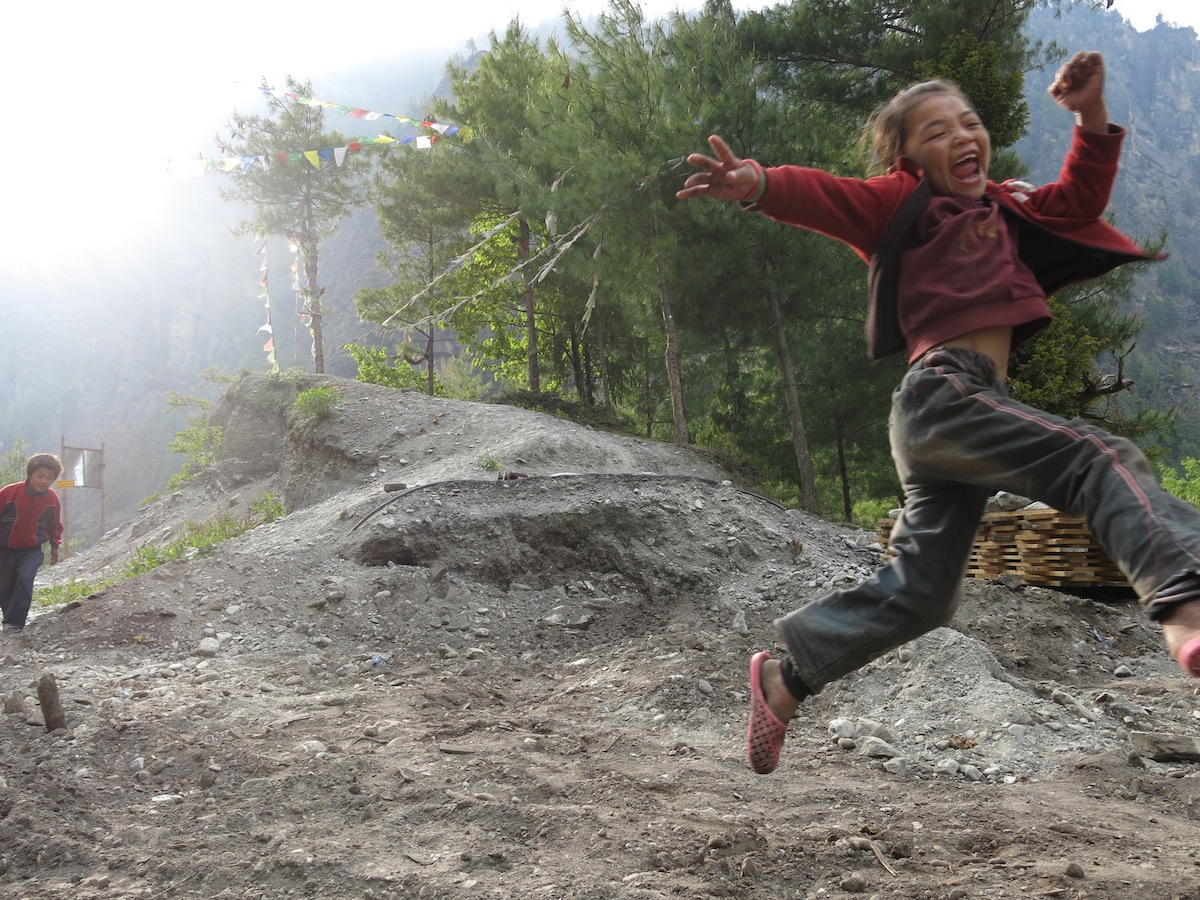 Girl jumping in Nepal