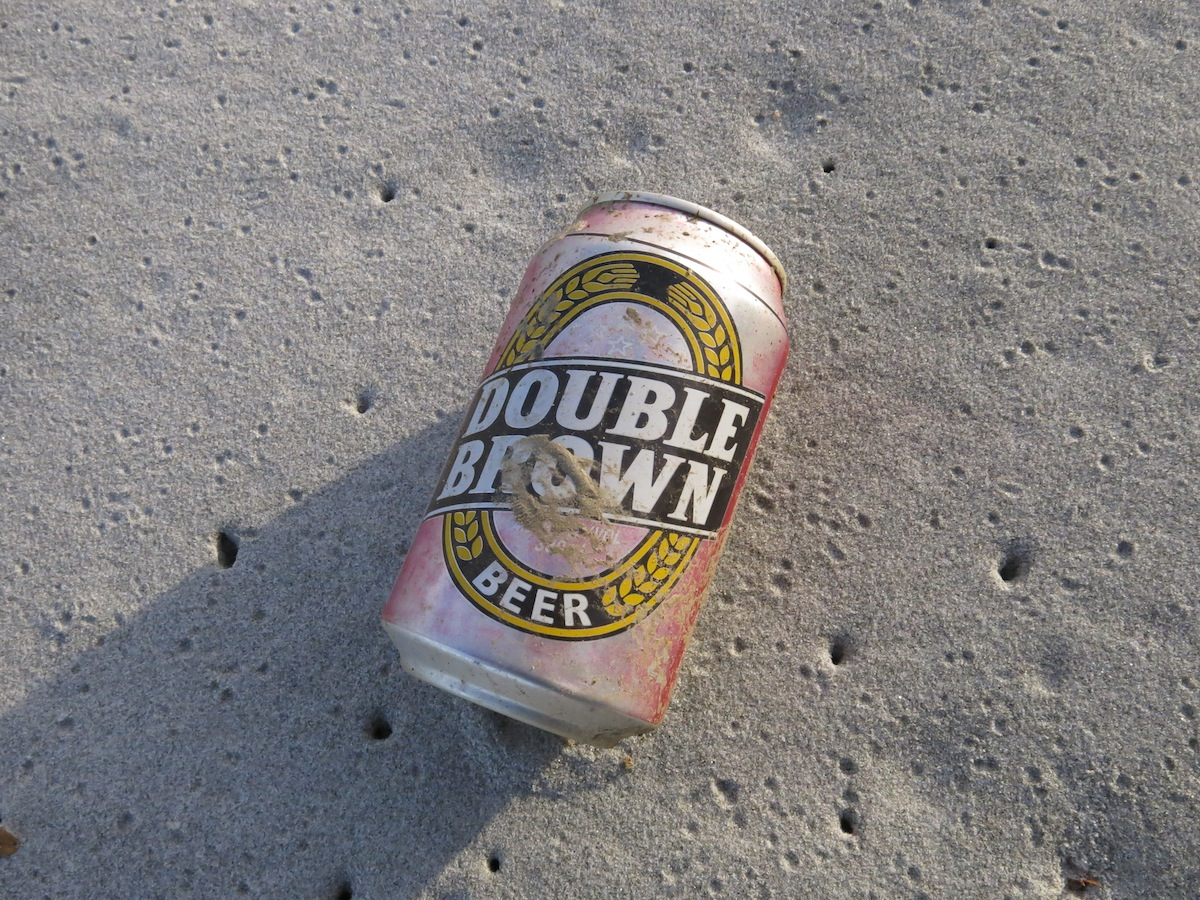 Beer can on beach