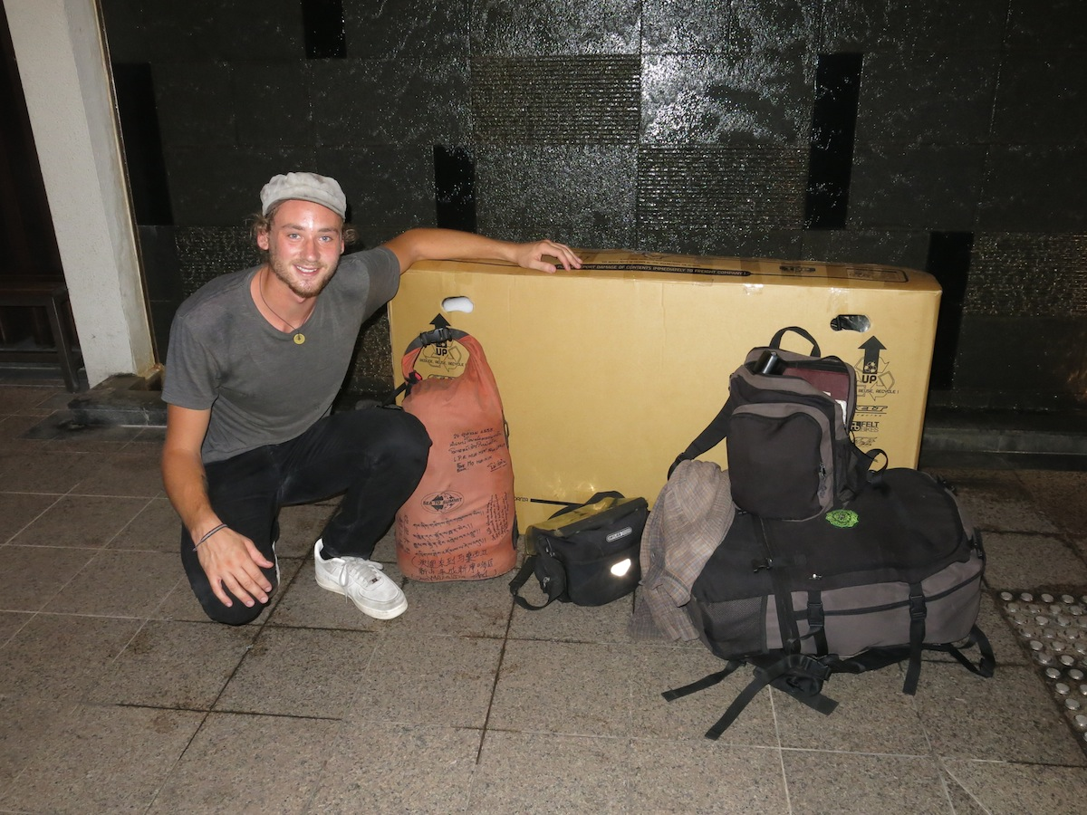 Erik Ohlson leaving Singapore with bicycle in box